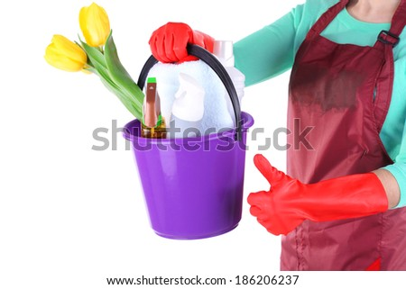 Housewife holding bucket with cleaning equipment. Conceptual photo of spring cleaning. Isolated on white