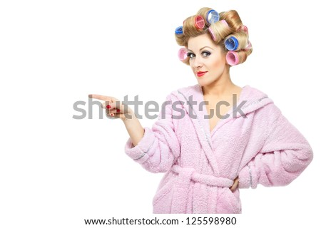 Housewife in pink bathrobe on white background - stock photo