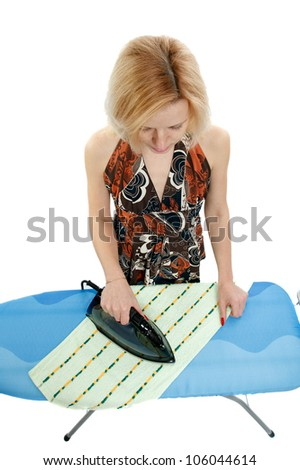 housewife ironing clothes,view from the top - stock photo