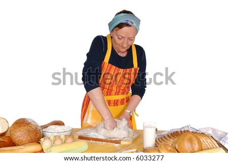 Housewife molding dough, making fresh home made bread.  Nutrition, food, cooking concept.