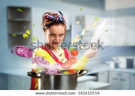 Housewife on the kitchen - stock photo