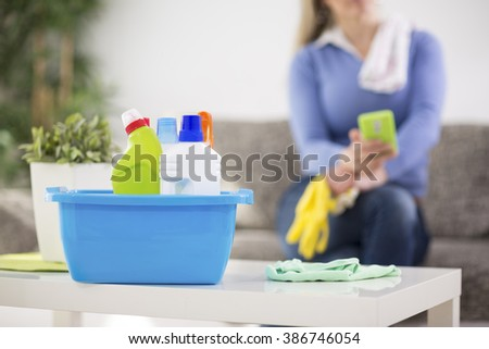 Housewife prepare cleaning products for cleaning house - stock photo