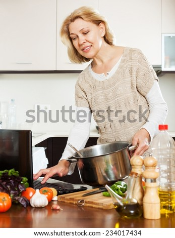Home Kitchen Cooking elderly woman cooking food home kitchen stock photo 95040037