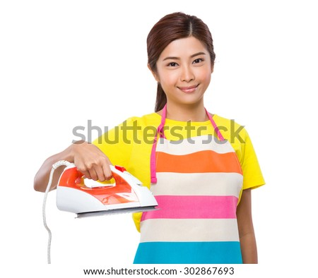 Housewife using the steam iron