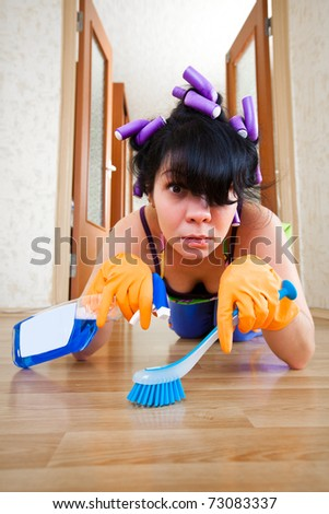 housewife washes a floor in the house