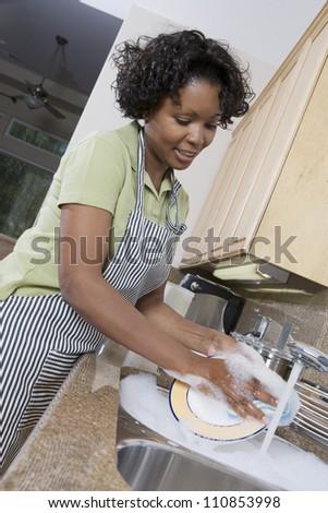Housewife Washing Dishes - stock photo