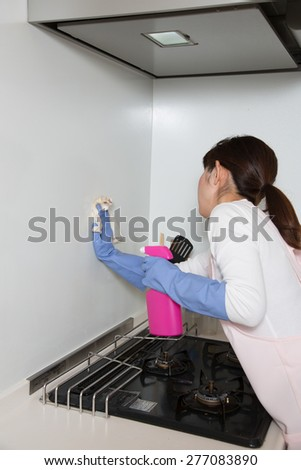 housewife washing wall