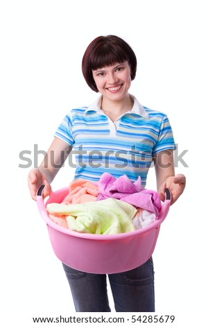 Housewife with laundry basket.  A young woman holding a basket of folded laundry. Time for laundry day. - stock photo