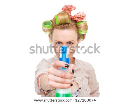 Housewife / woman spraying the cleaner on you, isolated on white. Glass or window cleaner - stock photo
