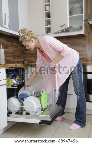 housewife working at the dishwasher
