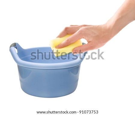 Housework. Hand with cleaning sponge and laundering wash basin isolated on white background