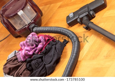 Housework - laundry and vacuum cleaner - stock photo