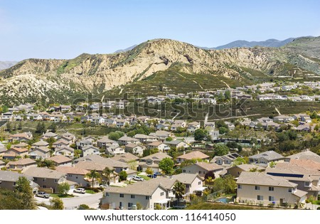 Housing community in southern Californian expands into the hillside. - stock photo