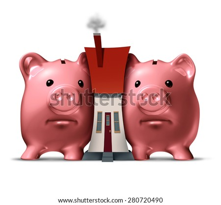Housing crunch and home crisis concept as two piggy banks putting the squeeze on a family house as an economic symbol of feeling financial pressure and finance stress from a real estate mortgage. - stock photo