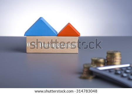 Housing Loan concept. House Wooden Block, coins and calculator with word 0% Downpayment  - stock photo