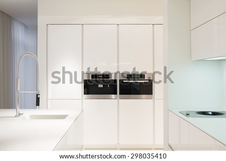 Housing oven and microwave in modern kitchen - stock photo