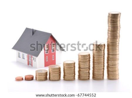 Housing prices going up concept. If you flip horizontal, housing prices goes down. - stock photo