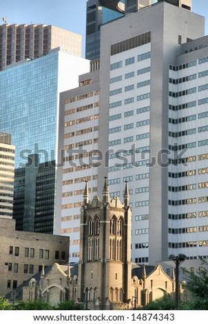 Houston Church Dwarfed by Skyscrapers(Release Information: Editorial Use Only. Use of this image in advertising or for promotional purposes is prohibited.) - stock photo