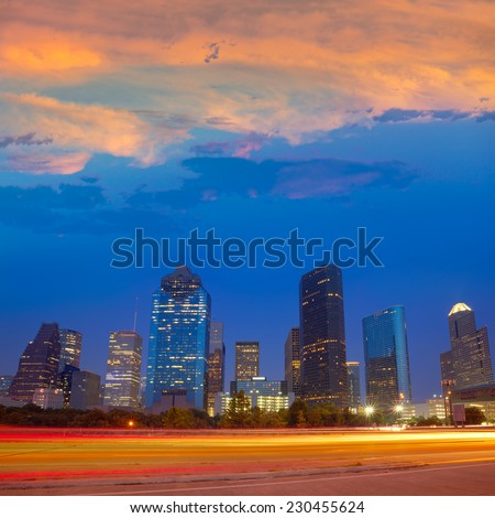 Houston downtown skyline at sunset dusk in Texas US USA - stock photo