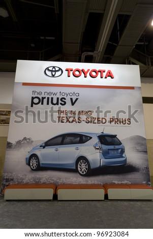 HOUSTON - JANUARY 28: A Toyota Prius Ad at the Houston International Auto Show on January 28, 2012 in Houston, Texas. - stock photo
