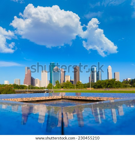 Houston skyline and Memorial reflection Texas USA US - stock photo