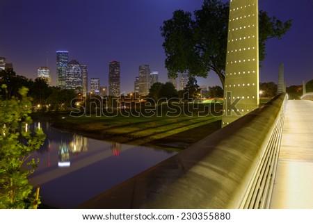 Houston sunset skyline from Memorial park at Texas US - stock photo