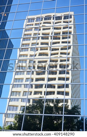 HOUSTON, TEXAS - APRIL 06, 2016: Skyscrapersreflection at Houston ,Texas - stock photo