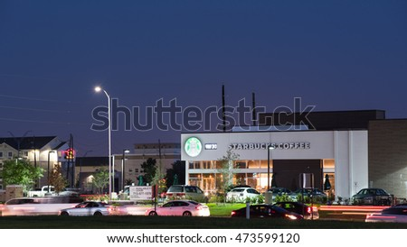 HOUSTON, TEXAS - AUG 23, 2016: exterior of Starbucks Cafe in Westchase district at night. Starbucks Corporation is an American global coffee company and coffeehouse chain based in Seattle, Washington.