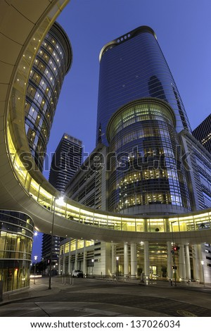 HOUSTON, TEXAS-MARCH 26: Modern Office Building at Twilight on March 26, 2013 in Houston, Texas. Chevron Corp. agreed to buy a 50-floor Office Building which used to be the headquarters of Enron Corp. - stock photo