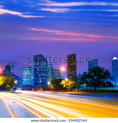 Houston Texas modern skyline at sunset twilight with traffic headlights lights trace - stock photo