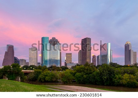 Houston, Texas  skyline at sunset twilight from park lawn - stock photo