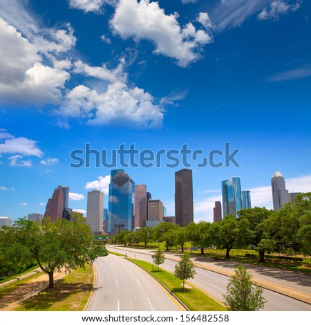 Houston Texas Skyline with modern skyscrapers and blue sky view from road - stock photo