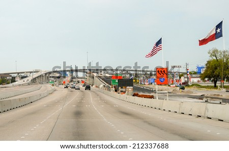 HOUSTON, TX - MAR 1, 2009: Traffic flows on the interstate to Houston, TX. Traffic congestions are a often a problem for many people going in and out. - stock photo
