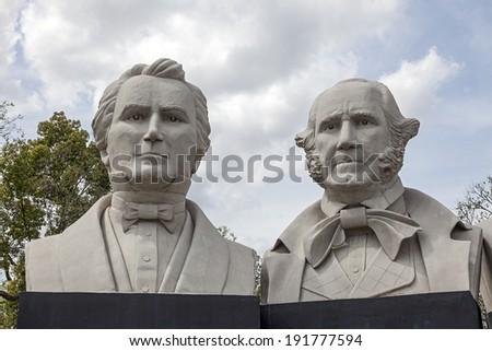 HOUSTON, TX - MARCH 21, 2013: American Statesmanship Park in Houston, Texas. Sculptures created with, Stephen F. Austin, Sam Houston, Abraham Lincoln and George Washington by Artist David Adickes. - stock photo