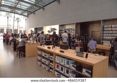 HOUSTON, US-SEPT 16, 2016: Sleekly designed spaces of Apple Store in Highland Village, Westheimer Rd. Customer browsing iPhone, iPad, MacBook, staffs help in product introduction and technical support