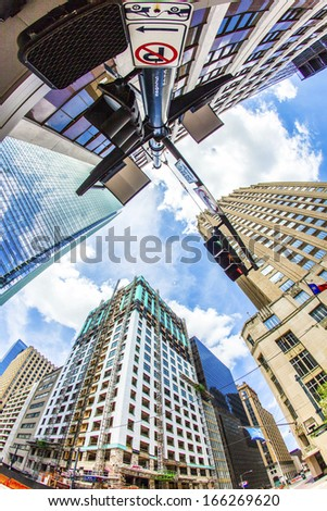 HOUSTON, USA - JULY 11: view to historic and modern skyscraper in downtown  on July 11, 2013 in Houston, USA. Historic District was the original town center of Houston and dates from the 19th century. - stock photo