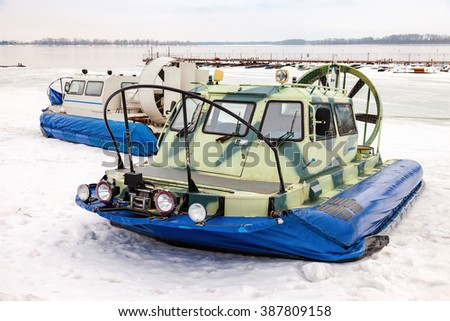 Hovercraft transporters at the Volga embankment in winter day