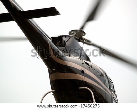 Hovering helicopter's tail closeup low angle view - stock photo