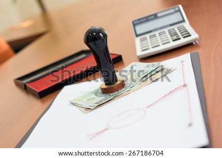 How much will the Notarial Service cost ? - Notary tools an money on desk - stock photo