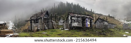 How the Wild West of America, Ukraine in the high mountains are abandoned villages resembling gold miners shack forgotten times. In the summer they live sheep and cattle herders - stock photo
