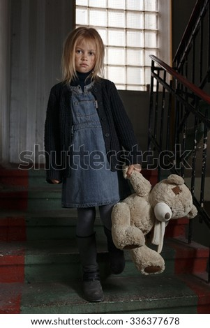How to find the way out. Poor unhappy depressed girl holding toy and going  down the staircase while feeling hopeless - stock photo