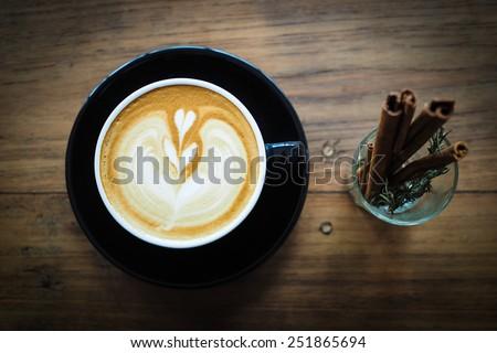How to make coffee latte art - stock photo