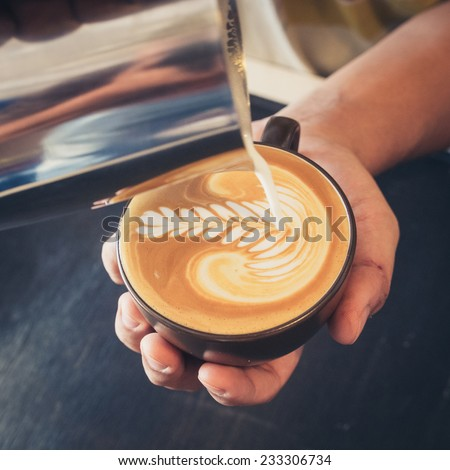 how to make latte art coffee - stock photo