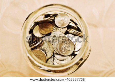 How to save money. Money in a glass jar