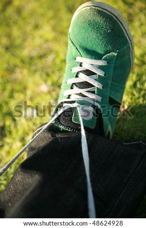 how to tie a shoe - stock photo