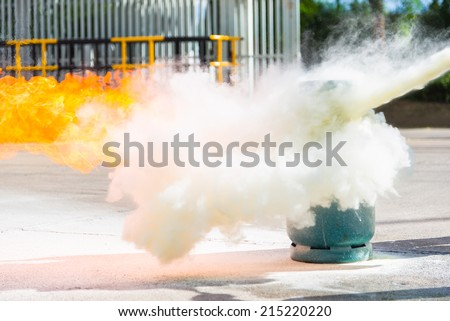 How to use a fire extinguisher with  gas container during training. - stock photo