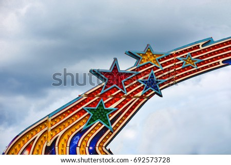 Howard County, Maryland - August 8, Stars on machinery that is part of a ride at the county fair on 8 August, 2017 in Howard County, Maryland, USA