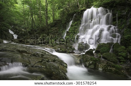 However falls located in the woods and running water