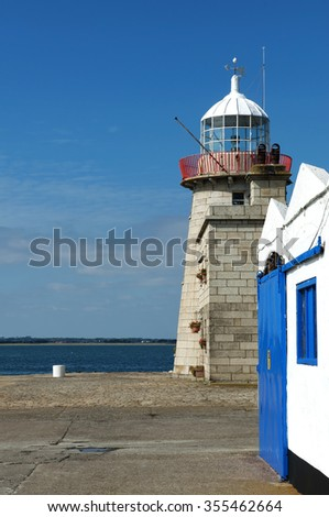 Howth lighthouse in county Dublin, Ireland. The lighthouse was built in 1817. - stock photo