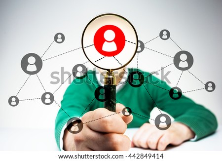 HR manager with magnifier choosing the right employee from his network.  Human resources management and recruitment concept - stock photo